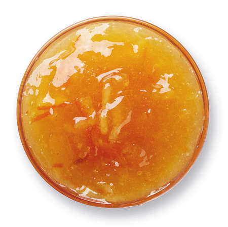Bowl of orange jam isolated on white background from top view 版權商用圖片