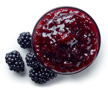 Bowl of blackberry jam isolated on white background from top view Stock Photo