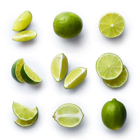 Set of fresh whole and cut lime and slices isolated on white background. From top view Фото со стока