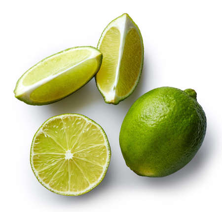 Fresh whole lime and slices isolated on white background. From top view