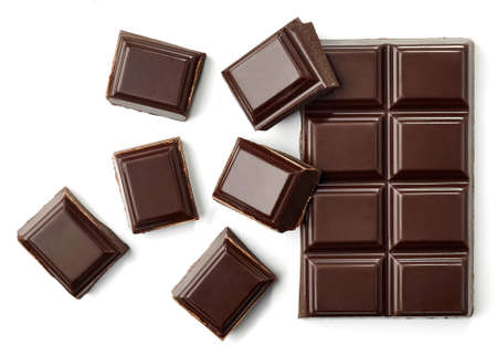 Dark chocolate pieces isolated on white background from top view Imagens