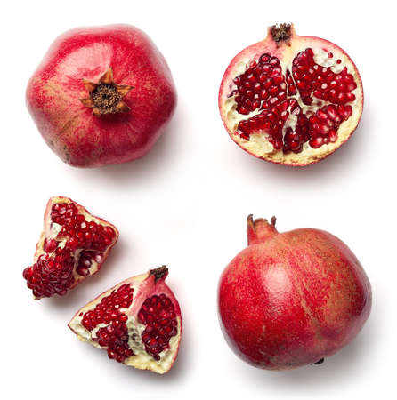 Fresh whole and half of pomegranate isolated on white background from top view