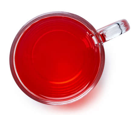 Cup of hot red berry tea isolated on white background. Top view