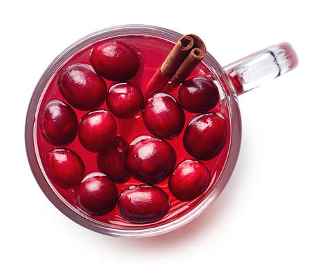 Cup of hot cranberries drink isolated on white background. Top view Stock Photo