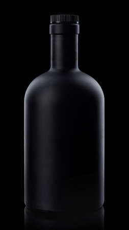 Black whiskey bottle on dark background Stock fotó