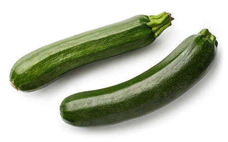 Two fresh whole zucchini isolated on white background. Top view