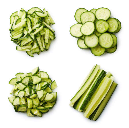Heap of fresh sliced cucumbers isolated on white background. From top view Фото со стока