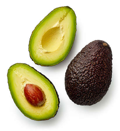 Geheel en snijd in halve avocado die op witte achtergrond wordt geïsoleerd. Bovenaanzicht Stockfoto - 94614115