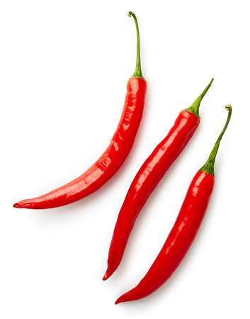 Three red hot chili peppers isolated on white background. Top view Standard-Bild