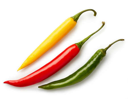Three colorful chili peppers isolated on white background. Top view