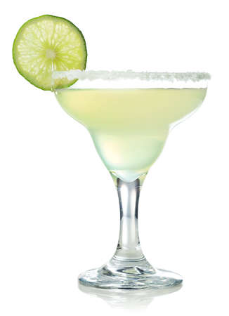 Glass of classic margarita cocktail decorated with slice of lime isolated on white background