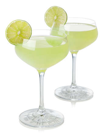 Two glasses of classic lime daiquiri cocktail isolated on white background