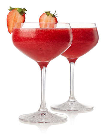 Two glasses of strawberry daiquiri cocktail isolated on white background Foto de archivo