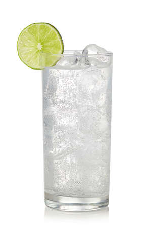 Glass of gin and tonic cocktail isolated on white background. Sparkling drink Stock Photo
