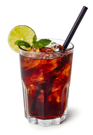 Glass of cuba libre or long islan iced tea isolated on white background