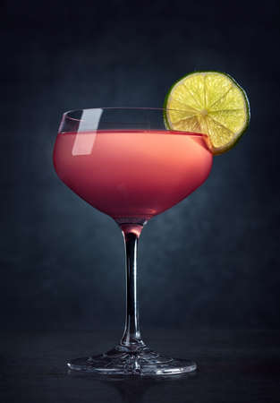 Glass of Cosmopolitan cocktail on dark background Stock fotó