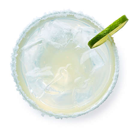 Glass of Margarita cocktail isolated on white background. Top view