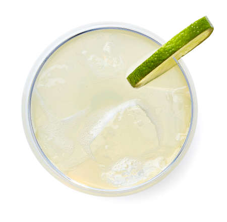 Glass of Classic Daiquiri cocktail with lime isolated on white background. Top view Banque d'images