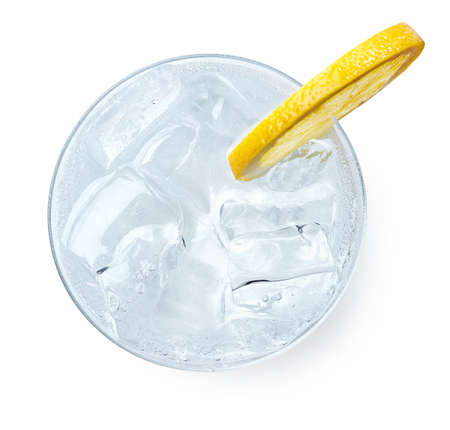 Glass of Gin and tonic with slice of lemon isolated on white background. Top view