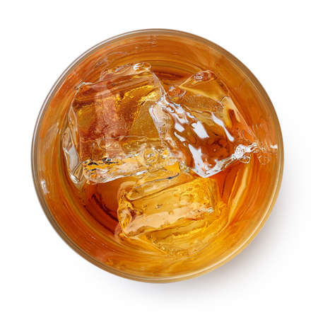 Glass of whiskey with ice isolated on white background. Top view 스톡 콘텐츠