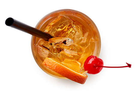 Glass of Old fashioned cocktail isolated on white background. Top view