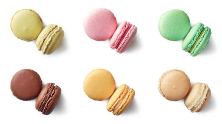 Colorful french macarons isolated on white background. Top view. Pastel colors