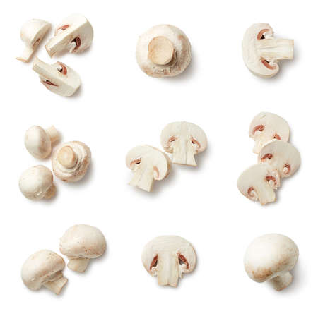 Set of fresh whole and sliced champignon mushrooms isolated on white background. Top view
