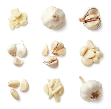 Set of fresh whole and sliced garlics isolated on white background. Top view
