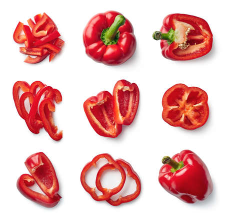 Set of fresh whole and sliced sweet red pepper isolated on white background. Top view Stockfoto
