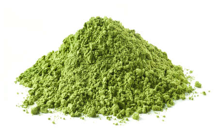 Heap of green matcha tea powder isolated on white background