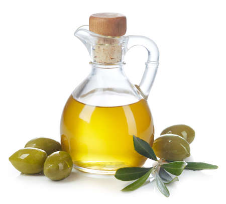 Bottle of fresh extra virgin olive oil and green olives with leaves isolated on white background