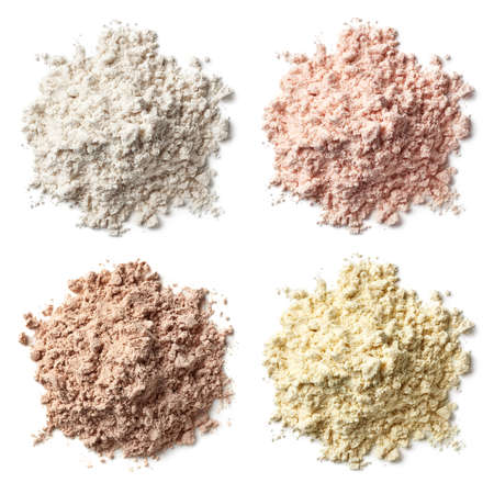 Four various heaps of protein powder (vanilla, strawberry, chocolate, banana) isolated on white background. Top view