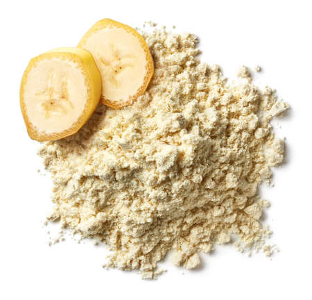 Heap of yellow banana protein powder isolated on white background. Top view Stock Photo