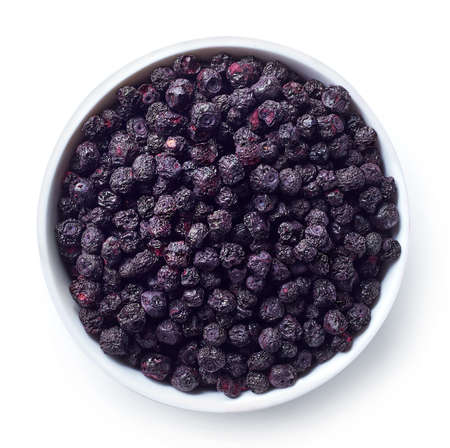 Bowl of freeze dried blueberries isolated on white background. Top view 스톡 콘텐츠