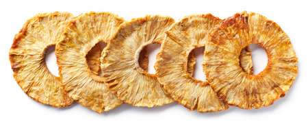 Row of freeze dried pineapple slices isolated on white background. Top view Foto de archivo - 107594308