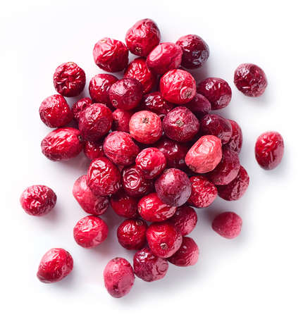 Heap of freeze dried cranberries isolated on white background. Top view Фото со стока