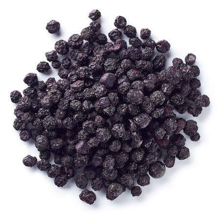Heap of freeze dried blueberries isolated on white background. Top view Imagens