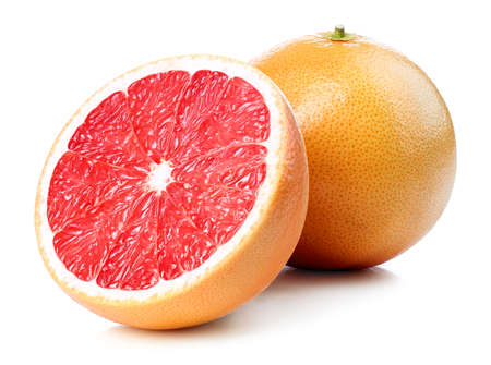 Whole and half of grapefruit isolated on white background Фото со стока