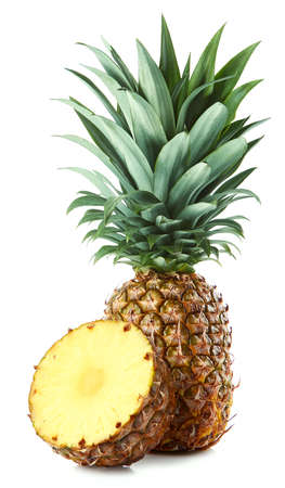 Fresh whole and sliced pineapple isolated on white background