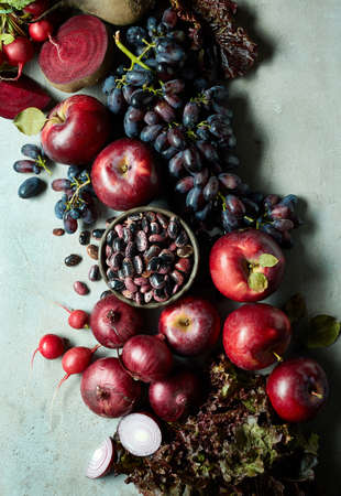 Fresh various pink, red and purple fruits and vegetables on gray marble background. Top view Archivio Fotografico - 109542454