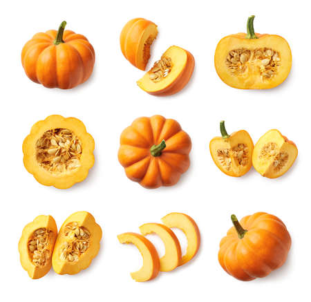Set of fresh whole and sliced pumpkin isolated on white background. Top view Фото со стока