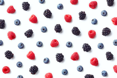 Fruit pattern of colorful wild berries isolated on white background. Raspberries, blueberries and blackberries. Top view. Flat lay Reklamní fotografie - 111975889