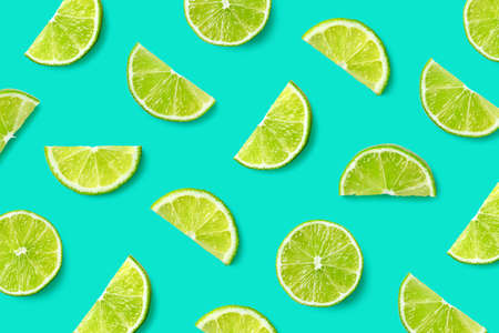 Colorful fruit pattern of lime slices on blue background. Top view. Flat lay