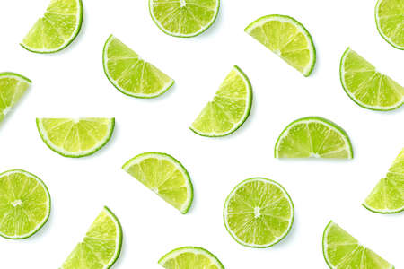Fruit pattern of lime slices isolated on white background. Top view. Flat lay