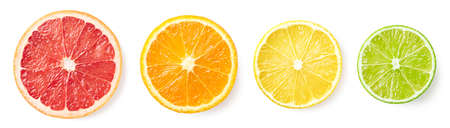 Colorful citrus fruit slices isolated on white