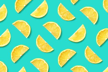 Colorful fruit pattern of lemon slices on blue Stock Photo