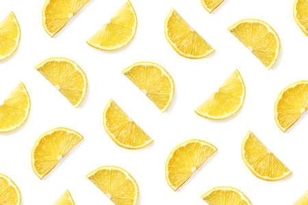 Fruit pattern of lemon slices isolated on white