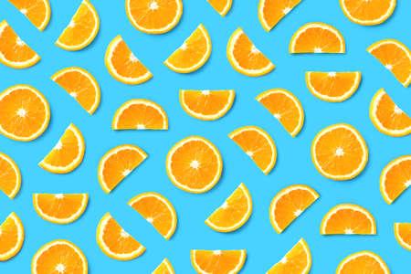 Colorful fruit pattern of orange slices on blue