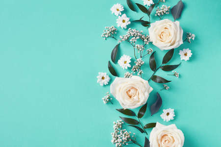 Beautiful white flowers composition on blue