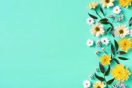 Beautiful yellow and white flowers composition on blue
